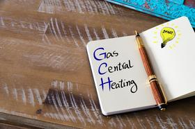 Image of note book with the words gas central heating written inside.